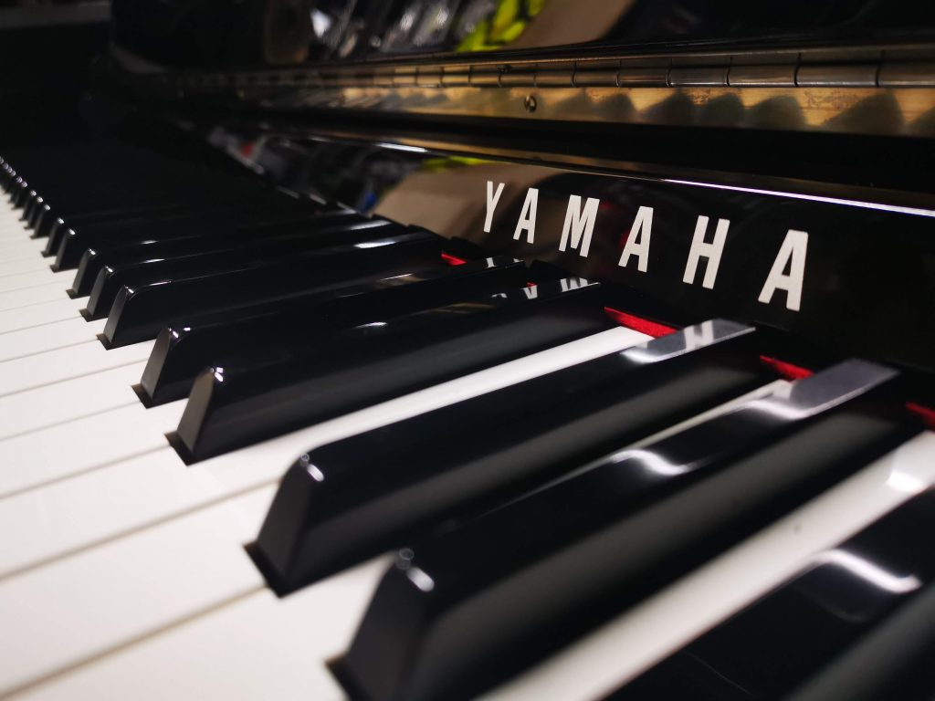 Close up of black and white yamaha keys for replacement